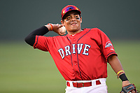 Catcher Isaias Lucena (19) of the Greenville Drive warms up before game two of a doubleheader against the Rome Braves on Tuesday, May 30, 2017, at Fluor Field at the West End in Greenville, South Carolina. Rome won, 10-7. (Tom Priddy/Four Seam Images)