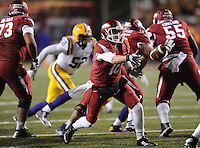 NWA Media/ANDY SHUPE - Arkansas' Brandon Allen pitches the ball against LSU during the fourth quarter Saturday, Nov. 15, 2014, at Razorback Stadium in Fayetteville.