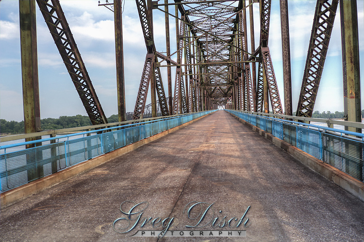 The Route 66 Chain of Rocks Bridge on the Missisippi River at St. Louis Missouri. <br /> The Old Chain of Rocks Bridge, at 5,353 feet<br /> long, is one of the world&rsquo;s longest bicycle and<br /> pedestrian bridges. The bridge spans the <br /> Mississippi River and provides a vital link in the <br /> b-state trail system, connecting to the MCT <br /> Confluence Trail in Illinois and the St. Louis <br /> Riverfront Trail in Missouri. The bridge has a<br /> rich history and was added to the National<br /> Register of Historic Places in 2006.