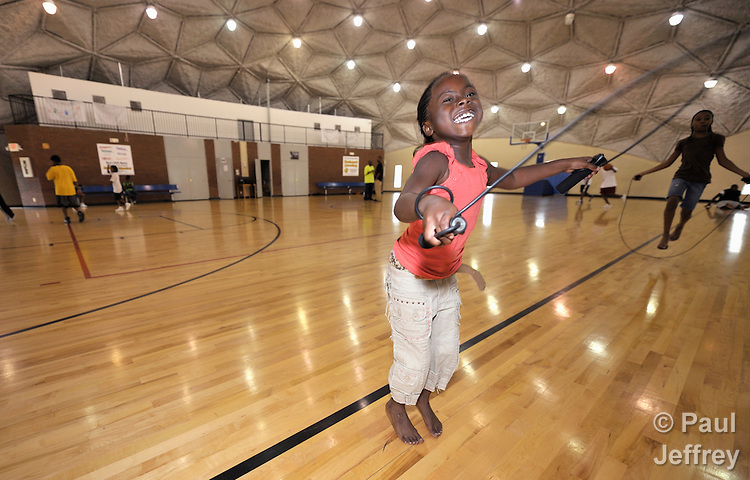 A girl skips rope in the Mary E. Brown Center, part of the Lessie Bates Neighborhood House in East St. Louis, Illinois.