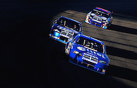 Nov. 16, 2008; Homestead, FL, USA; NASCAR Sprint Cup Series driver Ryan Newman (12) leads Kurt Busch and A.J. Allmendinger during the Ford 400 at Homestead Miami Speedway. Mandatory Credit: Mark J. Rebilas-