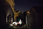 Delta Haweye Security guards Darien Wilson, left, and Jermond Tramble patrol a foreclosed home in Stockton, Calif., July 11, 2012. The bankrupt city has cut back on many services, while residents and private contractors are picking up the slack.