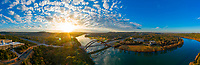 This aerial panorama view of the 360 Pennybacker Bridge offers a peaceful sunrise at Austin's most famous photographed landmark in Austin, Texas.