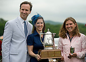Wendy Sloan Stengel (in the blue alongside husband Will), daughter of George Sloan, presents the trophy to Michele Sanger, owner of Fog Island, who won the race named after her family.