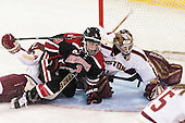 Meagan Mangene (BC - 24), Katie MacSorley (NU - 3), Corinne Boyles (BC - 29) - The Boston College Eagles defeated the Northeastern University Huskies 3-0 on Tuesday, February 11, 2014, to win the 2014 Beanpot championship at Kelley Rink in Conte Forum in Chestnut Hill, Massachusetts.