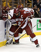 Nathan Gerbe (Boston College - Oxford, MI) battles Dylan Reese (Harvard University - Pittsburgh, PA) for the puck along the boards with some help from Brock Bradford (Boston College - Burnaby, BC). The Boston College Eagles defeated the Harvard University Crimson 3-1 in the first round of the 2007 Beanpot Tournament on Monday, February 5, 2007, at the TD Banknorth Garden in Boston, Massachusetts.  The first Beanpot Tournament was played in December 1952 with the scheduling moved to the first two Mondays of February in its sixth year.  The tournament is played between Boston College, Boston University, Harvard University and Northeastern University with the first round matchups alternating each year.