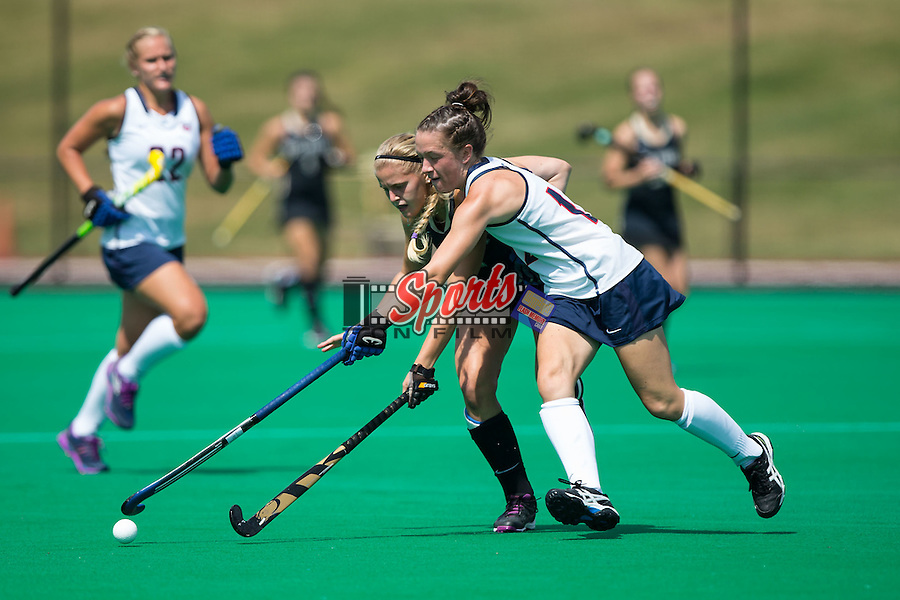Krysta Wangerin (15) of the Wake Forest Demon Deacons battles for the ball with Bethany Barr (12) of the Liberty Flames during first half action at Kentner Stadium on September 20, 2015 in Winston-Salem, North Carolina.  The Demon Deacons defeated the Flames 2-1.  (Brian Westerholt/Sports On Film)