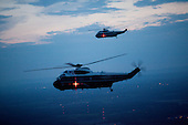 Washington, DC - May 28, 2009 -- Support helicopters fly at dusk with Marine One enroute to the South Lawn of the White House from Camp David, May 24, 2009. .Mandatory Credit: Pete Souza - White House via CNP