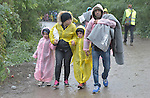 A refugee family approaches the border into Croatia near the Serbian village of Berkasovo. Hundreds of thousands of refugees from Syria and other countries have flowed through the Balkans on their way to western Europe.