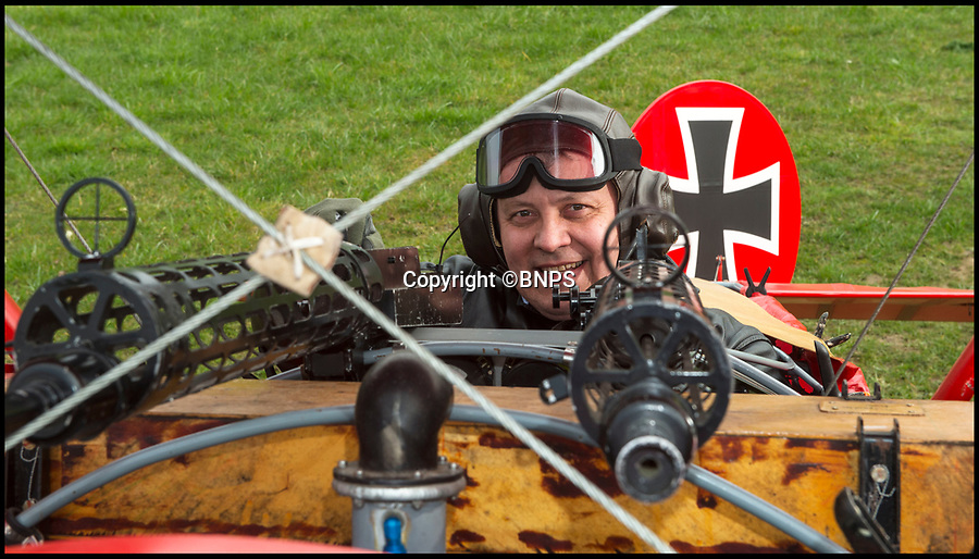 BNPS.co.uk (01202 558833)<br /> Pic: PhilYeomans/BNPS<br /> <br /> Baron Peter von Brueggemann looking down the barrels of his imitation Spandau machine guns...<br /> <br />  Dreaded Red Baron to fly again...WW1 Ace's feared 'Fokker Dreidecker' to finally fly over Britain.<br /> <br /> A German GP based in Norfolk has spent 8 years building a Fokker triplane in his garage as a tribute to infamous WW1 Ace Manfred von Ricthofen, who terrorised the skies over the Western front during the first war.<br /> <br /> Dr Peter Brueggemann, 52, will fulfil his childhood dream and emulate the notorious German fighter pilot when the Dreidecker Dr.1 fighter finally achieves lift-off this summer.<br /> <br /> Dr Brueggemann has even acquired the title Baron from the independent territory of Sealand so he can take to the skies as Baron Peter von Brueggemann in homage to his idol.<br /> <br /> The GP at the Holt Medical Practice in Norfolk hopes to be airborne in a few months once tests on the engine are completed at Felthorpe airfield near Norwich where he has devoted thousands of hours to the project.<br /> <br /> The father-of-two, who has lived in England with wife Sue for 20 years, has been taking flying lessons since his project began.