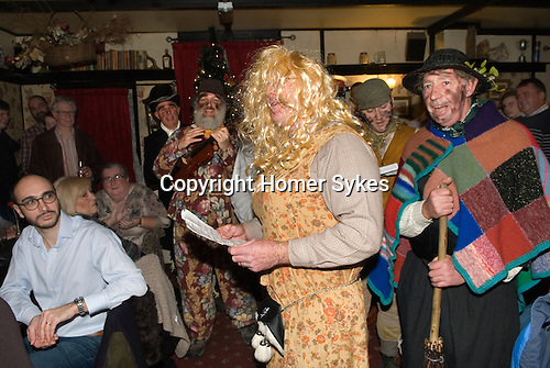 Hooden Horse performance at The Bell Inn Nicholas-at-Wade Kent UK 2014. The traditional characters are from L to R,  Waggoner,  George, a second Molly who also plays the Hooden Horse, the Boy, and Molly.