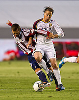 CARSON, CA - June 16, 2012: Chivas USA midfielder Alejandro Moreno (15) and Real Salt Lake midfielder Ned Grabavoy (20) during the Chivas USA vs Real Salt Lake match at the Home Depot Center in Carson, California. Final score Real Salt Lake 3, Chivas USA 0.