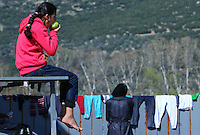 Pictured: A young girl eats an apple at the road block Tuesday 23 February 2016<br /> Re: Migrants on their way back to Athens have been caught by the blocked off motorway at Tembi, where local farmers have closed off the road, protesting against pension and welfare reforms near Trikala, Greece.