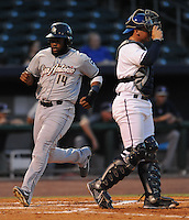 NWA Democrat-Gazette/ANDY SHUPE<br /> Northwest Arkansas Naturals catcher Parker Morin (right) watches as San Antonio left fielder Yeison Asencio crosses the plate Wednesday, Aug. 12, 2015, to score the first of four runs the Missions scored during the fifth inning at Arvest Ballpark in Springdale.