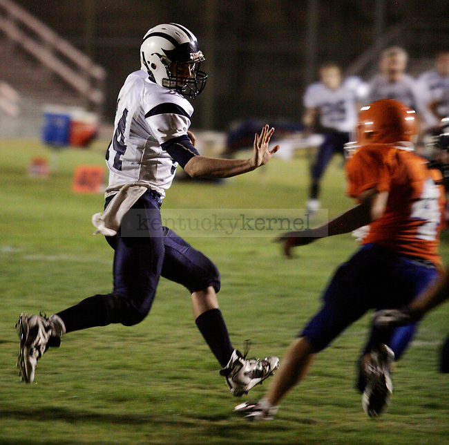 Quarterback Braxton Ratliff runs the ball against Pike County Central on Friday, Sept 18, 2009.