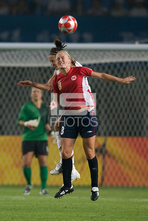USWNT defender (15) Kate Markgraf goes up for a header with Norwegian forward (8) Solveig Gulbrandsen during first round play for the 2008 Beijing Olympics in Qinhuangdao, China. .  The US lost to Norway, 2-0, at Qinhuangdao Stadium.