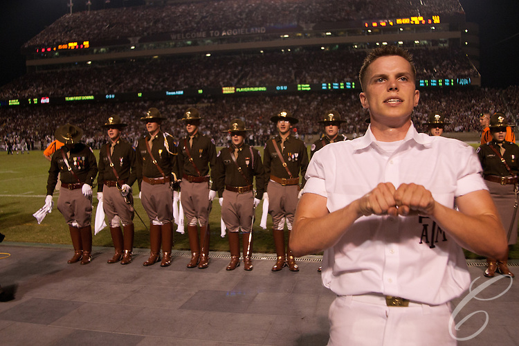 An Aggie Yell Leader leads the student body, known as the 12th Man, in the Aggie War Hymn during a football game at Kyle Field in 2007.  <br /> <br /> Behind the yell leader are the &quot;Officers of the Day,&quot; a group of Corps of Cadets seniors chosen to represent the 1800-member Corps of Cadets on the sidelines at each football game.