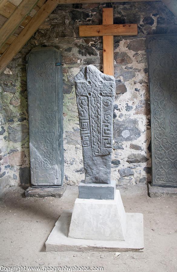 Replicas of ancient Celtic Christian crosses  inside Cille Bharra chapel, Eoligarry, Barra, Outer Hebrides, Scotland, UK