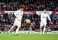 Sunday 07 December 2014<br /> Pictured: Ki Sung Yueng and Gylfi Sigurdsson of Swansea<br /> Re: Premier League West Ham United v Swansea City FC at Boleyn Ground, London, UK.