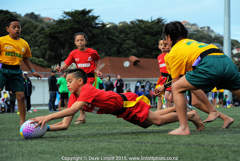 Action from the semifinal between Australia / Roscommon School (gold) and Georgia / Nawton School (red) on day two of the 2015 Rippa Rugby World Cup Tournament at Wakefield Park, Wellington, New Zealand on Tuesday, 15 September 2015. Photo: Dave Lintott / lintottphoto.co.nz