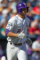 Louisiana State pinch hitter Tyler Moore (2) runs to first base against the North Carolina Tar Heels during Game 7 of the 2013 Men's College World Series on June 18, 2013 at TD Ameritrade Park in Omaha, Nebraska. The Tar Heels defeated the Tigers 4-2, eliminating LSU from the tournament. (Andrew Woolley/Four Seam Images)