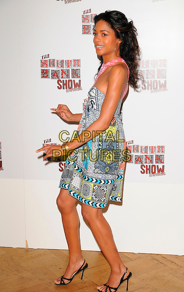 NAOMIE HARRIS.At The South Bank Show Awards,.The Dorchester Hotel, London, England,.January 30th 2008..full length blue pink black patterned print dress.CAP/CAN.©Can Nguyen/Capital Pictures