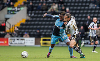 Gozie Ugwu of Wycombe Wanderers & Curtis Thompson of Notts County battle for the ball during the Sky Bet League 2 match between Notts County and Wycombe Wanderers at Meadow Lane, Nottingham, England on 28 March 2016. Photo by Andy Rowland.