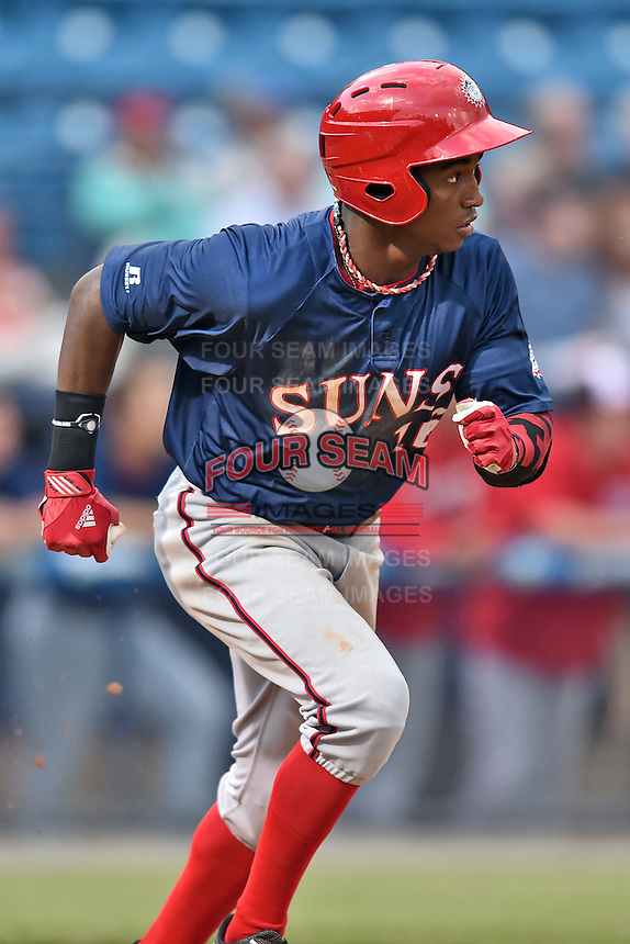 Hagerstown Suns center fielder Victor Robles (16) runs to first during a game against the Asheville Tourists at McCormick Field on April 26, 2016 in Asheville, North Carolina. The Suns defeated the Tourists 8-7. (Tony Farlow/Four Seam Images)