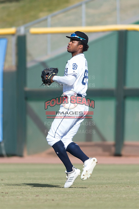 Peoria Javelinas right fielder Buddy Reed (85), of the San Diego Padres organization, prepares to make a throw to the infield during the Arizona Fall League Championship Game against the Salt River Rafters at Scottsdale Stadium on November 17, 2018 in Scottsdale, Arizona. Peoria defeated Salt River 3-2 in 10 innings. (Zachary Lucy/Four Seam Images)