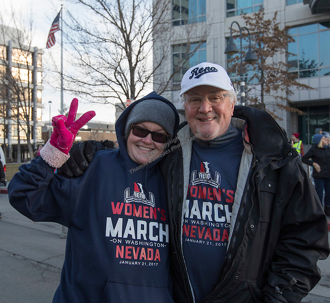 Tracy Fairhurst and Norman Stephens, from Reno, during the Reno Women's March on Washington event on Virginia Street in downtown Reno on Saturday, Jan. 21, 2017.