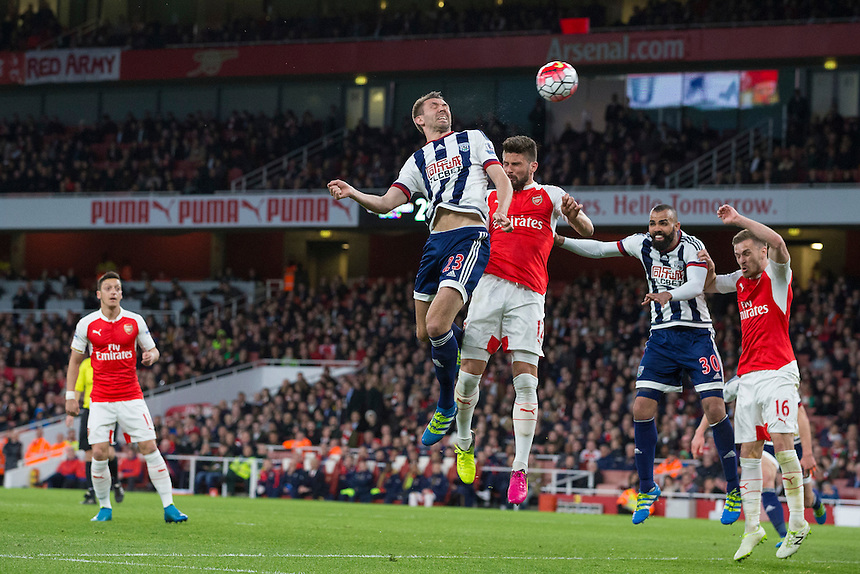 West Bromwich Albion's Gareth McAuley gets a header on goal<br /> <br /> Photographer Craig Mercer/CameraSport<br /> <br /> Football - Barclays Premiership - Arsenal v West Bromwich Albion - Thursday 21st April 2016 - Emirates Stadium - London<br /> <br /> &copy; CameraSport - 43 Linden Ave. Countesthorpe. Leicester. England. LE8 5PG - Tel: +44 (0) 116 277 4147 - admin@camerasport.com - www.camerasport.com