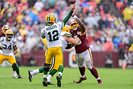 Landover, MD - September 23, 2018: Green Bay Packers quarterback Aaron Rodgers (12) throws a touchdown pass to Green Bay Packers wide receiver Geronimo Allison (81) right before halftime during game between the Green Bay Packers and the Washington Redskins at FedEx Field in Landover, MD. The Redskins get the win 31-17 over the visiting Packers. (Photo by Phillip Peters/Media Images International)