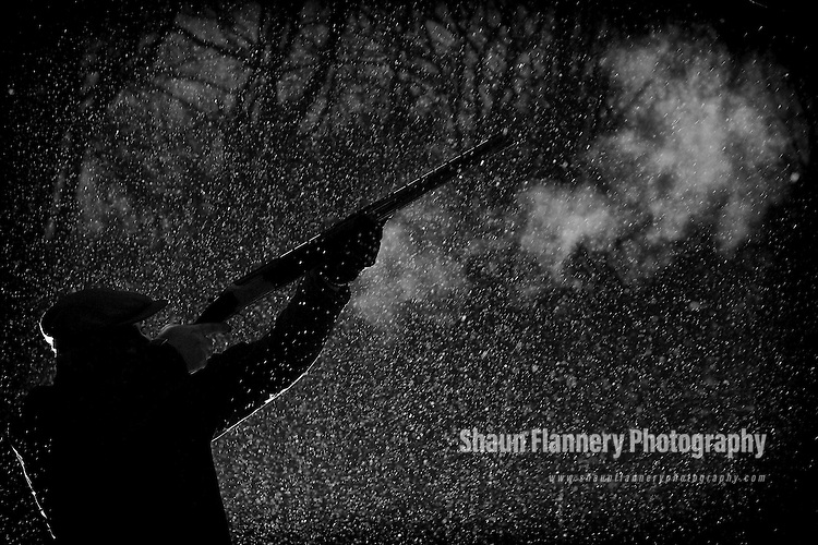 Pix: Shaun Flannery/shaunflanneryphotography.com...COPYRIGHT PICTURE>>SHAUN FLANNERY>01302-570814>>07778315553>>..4th February 2012……………..A gamekeeper fires a 20 bore shotgun during a snow storm.