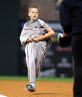Eleven-year-old Tyler Scholl of Powdersville, S.C., plays a game requiring him to put on a drive uniform and run the bases in-between innings of the Opening Day game between the Greenville Drive and Lakewood BlueClaws on April 5, 2012, at Fluor Field at the West End in Greenville, South Carolina. (Tom Priddy/Four Seam Images)