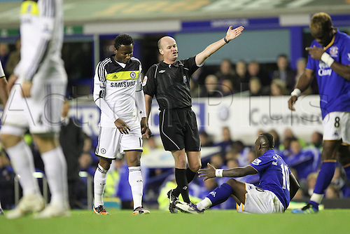 26.10.2011. Liverpool, England. Mikel concedes a free kick as he brings down Royston Drenthe in action in the Carling Cup match between Everton and Chelsea at Goodison Park. Mandatory Credit ActionPlus.