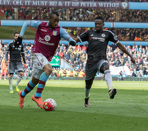 02.04.2016. Villa Park, Birmingham, England. Barclays Premier League. Aston Villa versus Chelsea.  Aston Villa striker Jordan Ayew on the attack with the ball closely marked by Chelsea defender Baba Rahman.