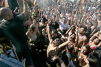 INDIO, CA - APRIL 26, 2008:  Members of the group Lucent Dossier sprya teh crowd of festival goerswith water to cool them down.  Temperatures again reached 99 degrees during the music festival in Indio.  This is the 9th annual Coachella Valley Music and Arts Festival in Indio. CA. held on April 25-27, 2008.  Photo by Spencer Weiner and Jay L. Clendenin.