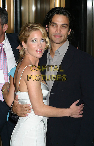 "CHRISTINA APPLEGATE & JONATHAN SCHAECH.""Anchorman The Legend of Ron Burgundy""- New York Premiere - Outside Arrivals, The Museum of Television & Radio.New York City, New York .July 7, 2004 .half length, corset style top, dress, arm around waist, embrace.www.capitalpictures.com.sales@capitalpictures.com.©Capital Pictures"