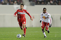 Peter Lowry (8) of the Chicago Fire is chased by Dane Richards (19) of the New York Red Bulls during the first half of a Major League Soccer match between the New York Red Bulls and the Chicago Fire at Red Bull Arena in Harrison, NJ, on March 27, 2010. The Red Bulls defeated the Fire 1-0.