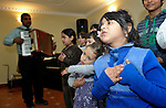 The children's choir sings during a worship service of the United Methodist Roma congregation in Jabuka, Serbia..