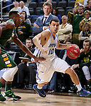 SIOUX FALLS, SD - MARCH 7:  Max Landis #10 of Fort Wayne dribbles past Carlin Dupree #3 of North Dakota State in the 2016 Summit League Tournament. (Photo by Dave Eggen/Inertia)