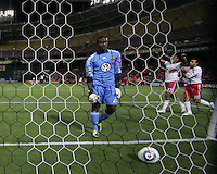 Bill Hamid (28) of D.C. United retrieves the ball as Juan Agudelo (17) and Dwayne De Rosario (11) of the New York Red Bulls celebrate the fourth goal during an MLS match at RFK Stadium, in Washington D.C. on April 21 2011. Red Bulls won 4-0.