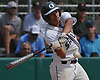 Leo Alvarez #11 of Oceanside connects for an RBI single in the bottom of the first inning of Game 1 of the best-of-three Nassau County varsity baseball Class AA final against Massapequa at SUNY Old Westbury on Saturday, May 26, 2018.