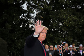 United States President Donald J. Trump waves as he walks on the South Lawn of the White House before boarding Marine One on January 13, 2020 in Washington, DC. President Trump and first lady Melania Trump will attend the College Football Playoff National Championship in New Orleans, Louisiana.<br /> Credit: Oliver Contreras / Pool via CNP