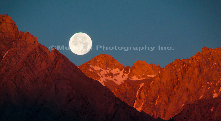 full moon over Sierra Nevada Mountains, Alabama Hills Recreation Area, California