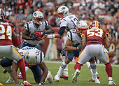 New England Patriots quarterback Tom Brady (12) hands the ball to New England Patriots running back Sony Michel (26) in fourth quarter action against the Washington Redskins at FedEx Field in Landover, Maryland on Sunday, October 6, 2019.  The Patriots won the game 33 - 7.<br /> Credit: Ron Sachs / CNP