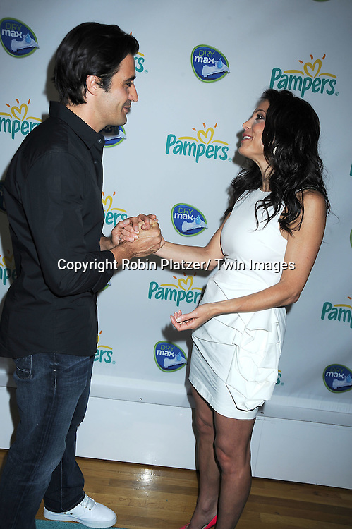 """Gilles Marini and Bethenny Frankel attending the kick-off of Father's Day week with  The Pampers with Dry Max Pays Homage to """"Dads on Diaper Duty""""  event on June 17, 2010 at The Metropolitan Pavilion in New York City."""