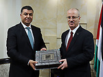 Palestinian Prime minister, Rami Hamadallah, meets with a Jordanian Minister of Agriculture Khalid Al Hanifat, in the West Bank city of Ramallah,on August 17, 2017. Photo by Prime Minister Office