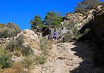 Woman walking in Sierra Alhamilla mountains, Nijar, Almeria, Spain