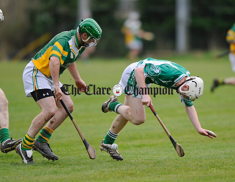 Templederry's Tom Ryan stumbles under pressure from Broadford's Padraig Hickey during the Intermediate Club Championship quarter final at Scariff. Photograph by John Kelly.
